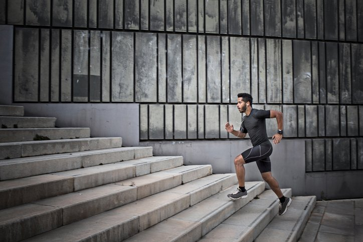 young man jogging on the stairs instead of a gym