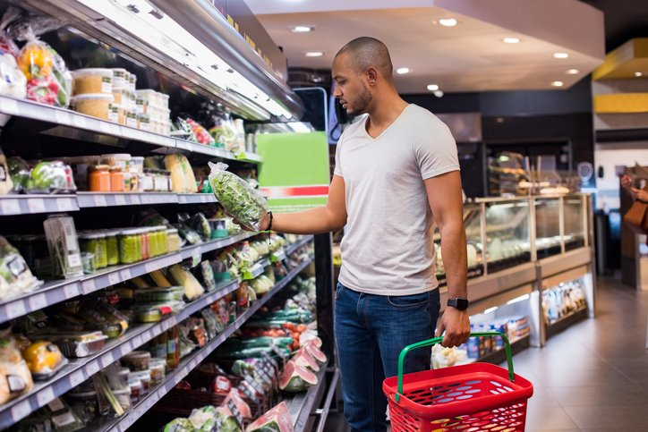 man grocery shopping at store