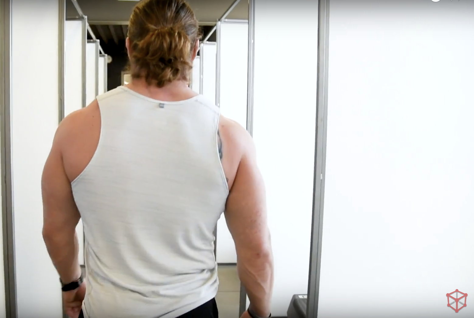 Bodybuilder walks the halls of Kubex Fitness.