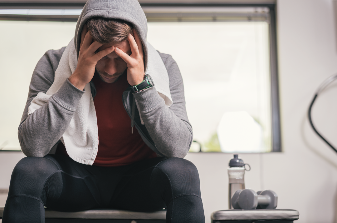 man at the gym feeling unmotivated